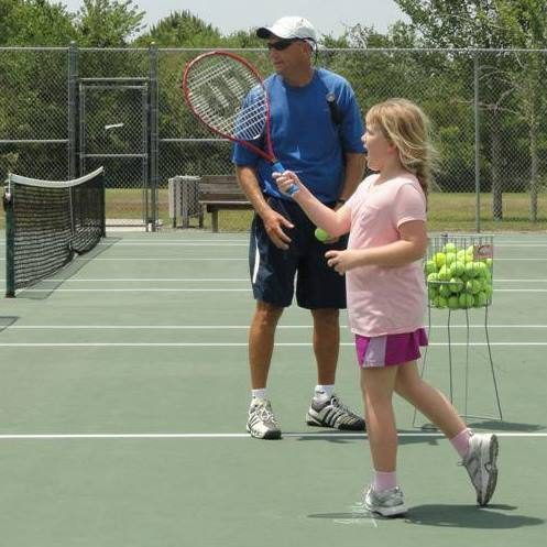 Junior Girl taking a tennis lessons with Traveling Tennis Pros